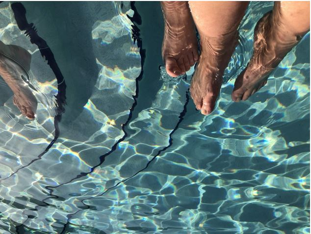 Our feet in the pool