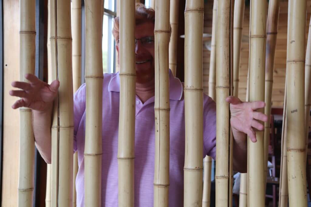 Gary pretending to be in bamboo jail.