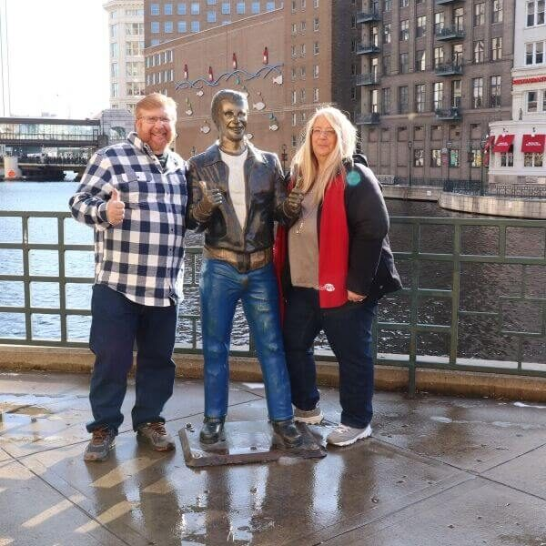 Gary and Michelle visiting the bronz Fonz in Milwaukee