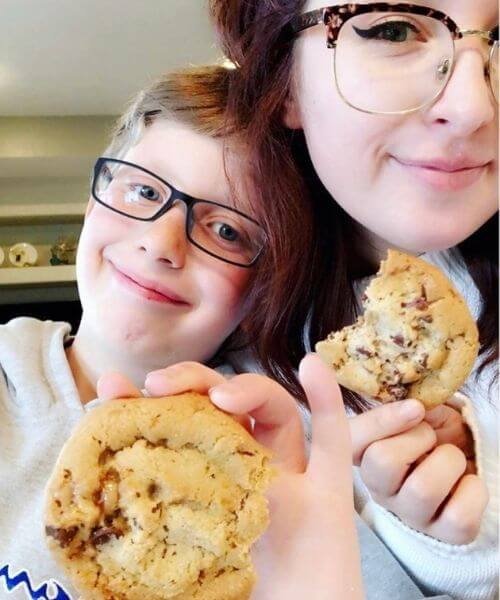 My grandson enjoying fresh backed cookies with his aunt