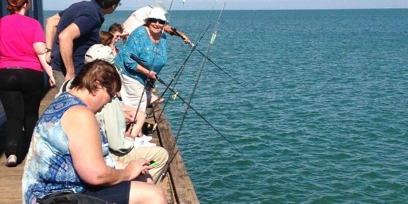 Locals fishing off the city pier