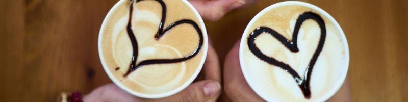 Romantic Christmas date ideas for couples, coffee with hearts