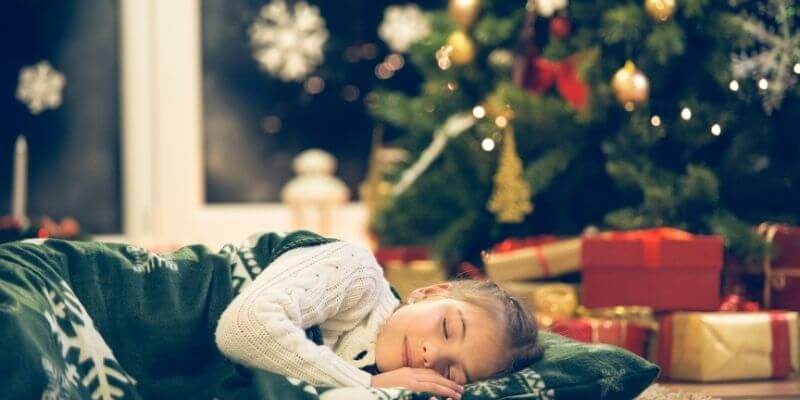 A Christmas tradition of sleeping under the Christmas tree