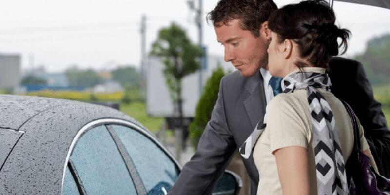 opening her car door